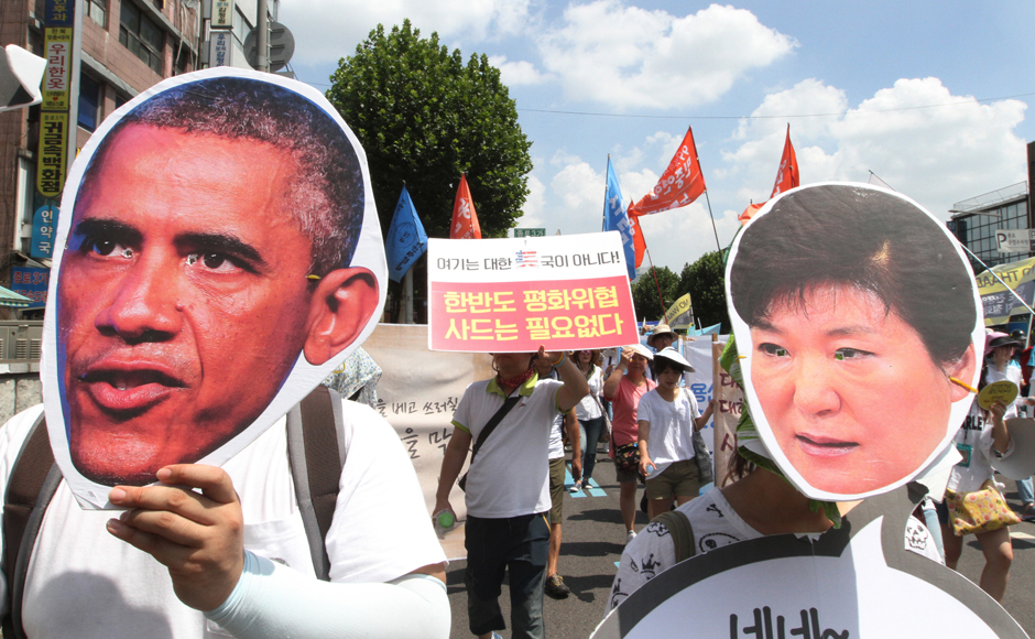 South Korean protesters wearing masks of US President Barack Obama and South Korean President Park Geun-hye, march to oppose a plan to deploy an advanced US missile defense system called Terminal High-Altitude Area Defense, or THAAD, in Seoul, South Korea, Monday, 15 August, 2016. AP