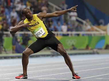 Usain Bolt from Jamaica celebrates winning the gold medal in the men's 200-meter final. AP