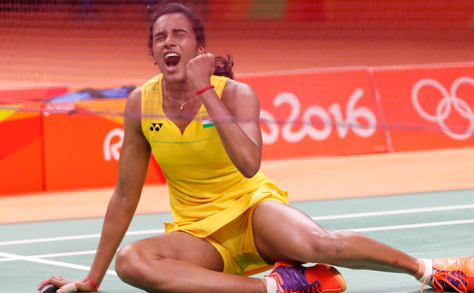 India's PV Sindhu caused a huge upset, stunning World number two Wang Yihan of China in straight games in the women's singles quarterfinals. AP