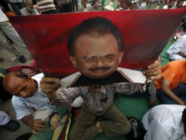 Supports of MQM hold poster of chief Altaf Hussain. Reuters
