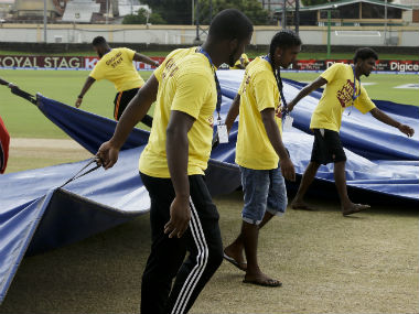 Covers being brought out by the ground staff on Day 2 of the 4th India-West Indies Test. AP