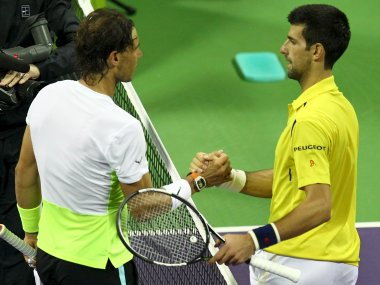 File photo of Novak Djokovic and Rafael Nadal at the Qatar Open. Reuters