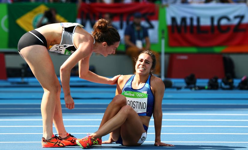 Abbey D'Agostino and Nikki Hamblin after a collision during the Women's 5000m Round 1. Getty