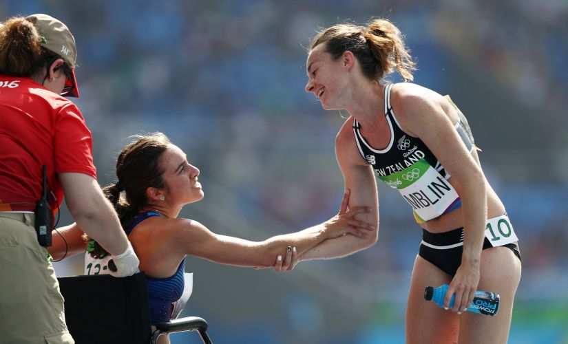 Abbey D'Agostino talks with Nikki Hamblin. Getty