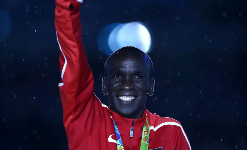 Gold medalist Eliud Kipchoge celebrates during the medal ceremony. Getty
