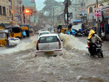 Waterlogging at a road after heavy rains lashed Hyderabad on Wednesday. PTI