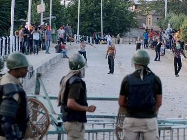 A file photo of protesters clashing with the security forces in Kashmir. PTI