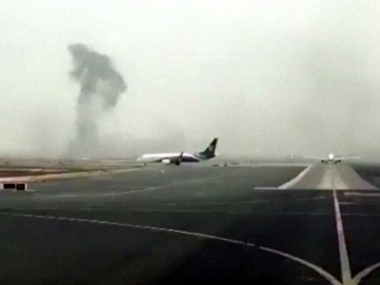 This image made from video shows smoke rising after an Emirates flight crash landed at Dubai International Airport on Wednesday. AP