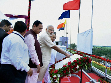 Prime Minister Narendra Modi releases water from the gates, at AJI-3 dam site of the project, in Jamnagar district, Gujarat on Tuesday. Gujarat Chief Minister Vijay Rupani is also seen. PTI