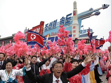 parade participants march with a model of the Unha space launch vehicle at the Kim Il Sung Square. AP
