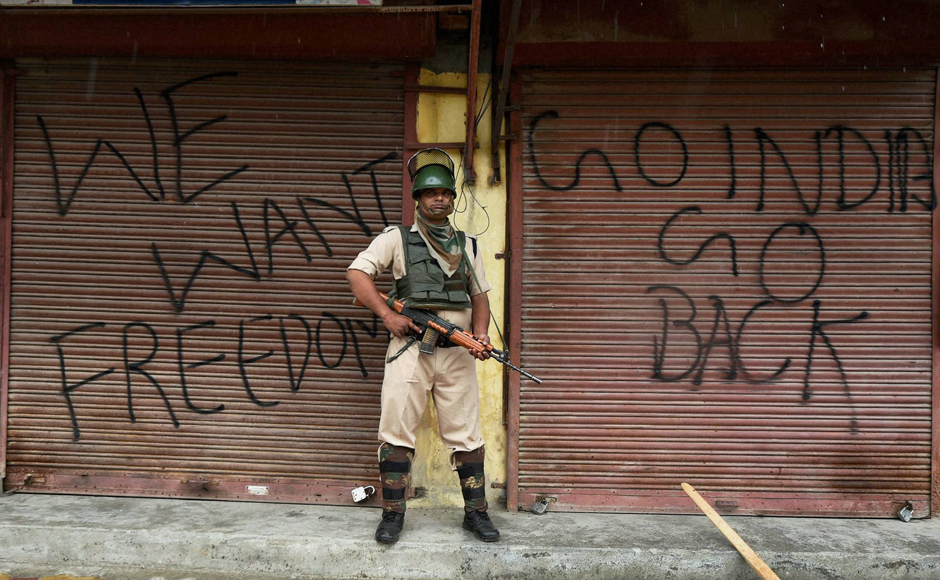 Srinagar: As curfew enters its 50th day in Kashmir, a CRPF personnel stands on guard amidst chants of 'Azadi' ringing through out the valley . PTI