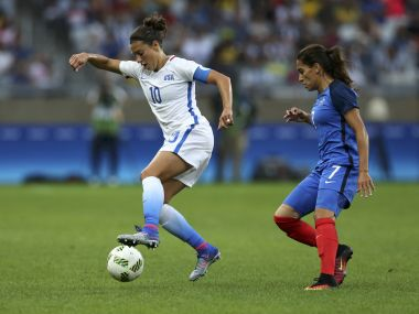 Carli Lloyd and Amel Majri France in action. Reuters