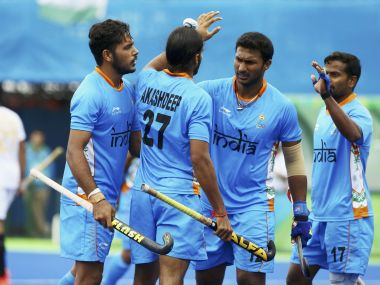 Akashdeep Singh with his teammates after scoring a goal. Reuters