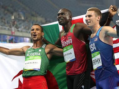 Winner Kenya's David Lekuta Rudisha, second placed Algeria's Taoufik Makhloufi, left, and third placed United States' Clayton Murphy celebrate after the men's 800-meter final. AP