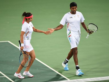 Sania Mirza and Rohan Bopanna celebrate after winning their quarter-finals. AFP