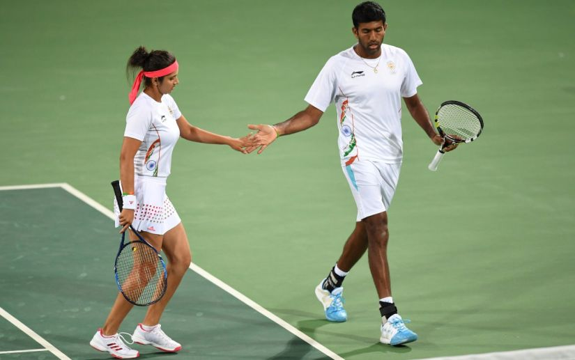 Sania Mirza and Rohan Bopanna after winning a point. AFP