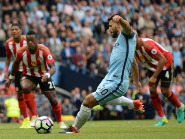 Manchester City's Sergio Aguero scores the opening goal from the penalty spot. AFP
