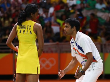 PV Sindhu talks to her coach Gopichand during the Women's Singles Gold Medal Match. Getty