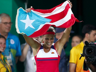 Monica Puig of Puerto Rico celebrates her country's first ever Olympic gold medal. AP