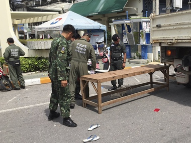 Investigators work at the scene of an explosion in the resort town of Hua Hin, Thailand. The blast followed a series of two explosions in Hua Hin Thursday evening that left one person dead and a number injured.AP