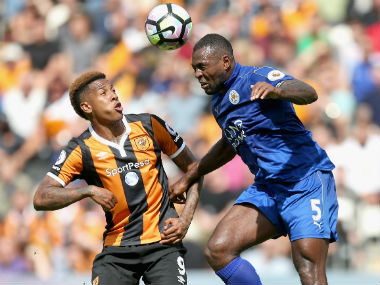 Wes Morgan (right) of Leicester heads the ball as Hull City's Abel Hernandez looks on . Getty