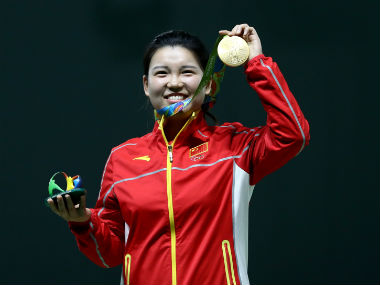 China's Zhang Mengxue poses with the gold medal after winning the women's 10m air rifle event. Getty Images