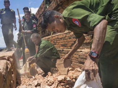 Myanmar Military personnel examine the Htilominlo Pagoda in Bagan, Myanmar. AP