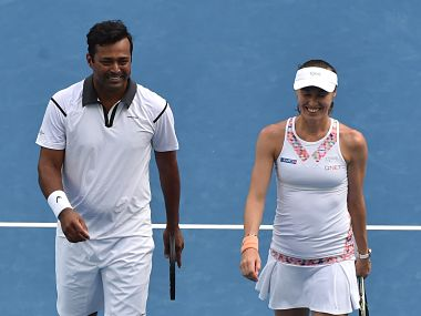 India's Leander Paes and Switzerland's Martina Hingis smile following their victory in their mixed doubles match. AFP
