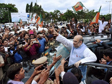Kozhikode: BJP National President Amit Shah being welcomed on his arrival at the aiport in Kozhikode on Thursday for National Council Meet. PTI Photo (PTI9_22_2016_000225B)