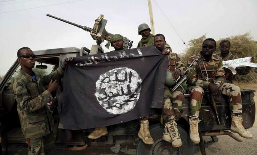 Nigerian soldiers hold up a Boko Haram flag. Reuters