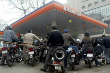 Motorists wait for their turn to fill petrol at a gas station in Lucknow. Reuters