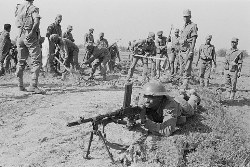 Indian troops repairing the Jessore Road from Kolkata in India to Jessore in Bangladesh, during the Indo-Pakistani War of 1971, part of the Bangladesh Liberation War, December 1971. The soldier in the foreground is using a Bren light machine gun. (Photo by William Lovelace/Daily Express/Getty Images)