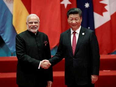 PM Modi and President Xi Jinping shake hands in the G20 summit, 2016. Reuters