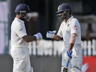 Murali Vijay and Cheteshwar Pujara (left) were batting on 64 and 50 respectively. AP