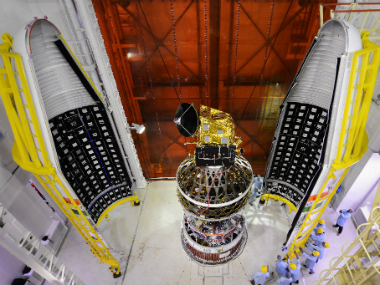 SCATSAT-1 spacecraft integrated with PSLV-C35 with two halves of the heat shield seen. Image: Isro