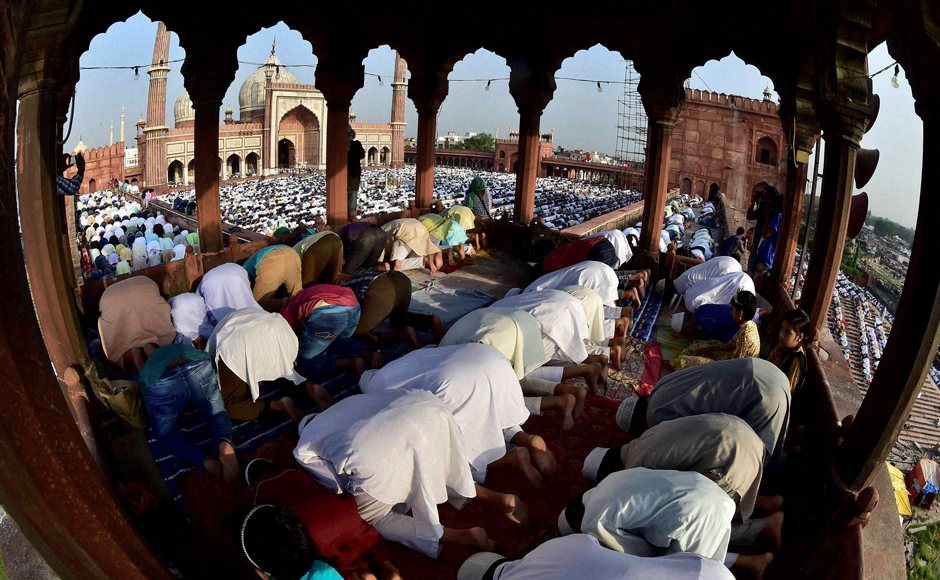 "Muslims offer Eid al-Adha prayers at Jama Masjid in New Delhi on Tuesday. Muslims worldwide are celebrating Eid al-Adha, or ""Feast of Sacrifice,"" that commemorates the willingness of the Prophet Ibrahim to sacrifice his son before God stayed his hand. During the holiday, Muslims slaughter livestock and distribute part of the meat to the poor. (Photo: PTI)"