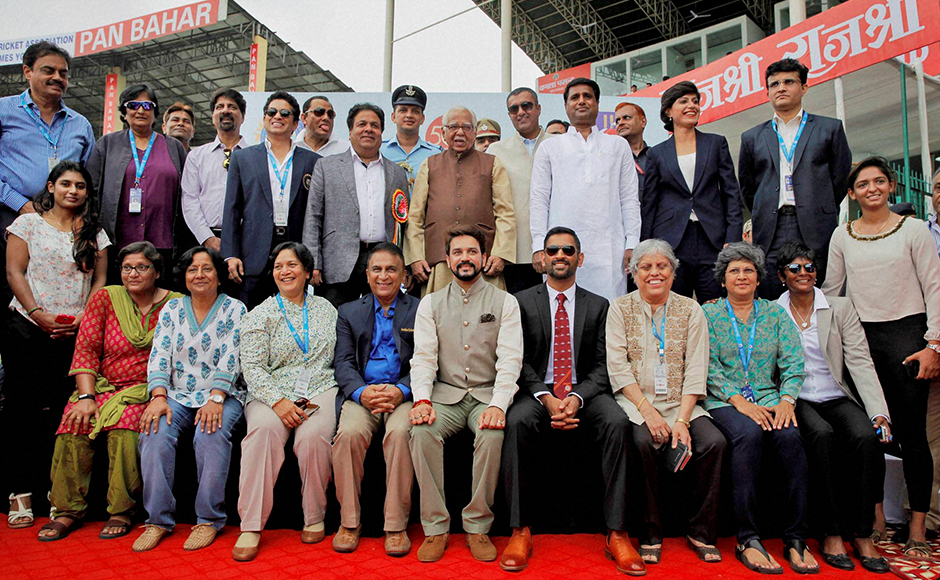 India's former test captains pose for a group photo with dignitaries after a felicitation ceremony to mark the 500th cricket test of the team in Kanpur on Thursday. PTI