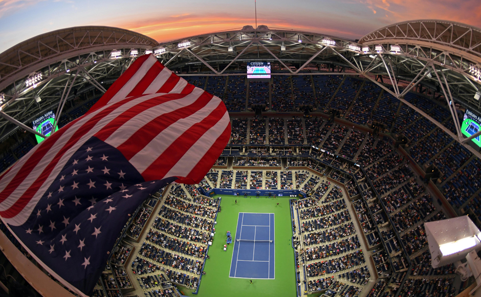 The sun sets on New York City as Grigor Dimitrov of Bulgaria and Andy Murray of Britain play out a tennis match at the Billie Jean King National Tennis Center, at the US Open 2016. Image courtesy: Reuters
