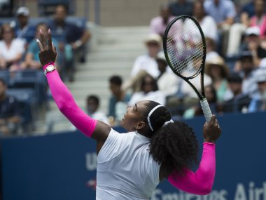 Serena Williams serves to Johanna Larsson at the US Open. AFP