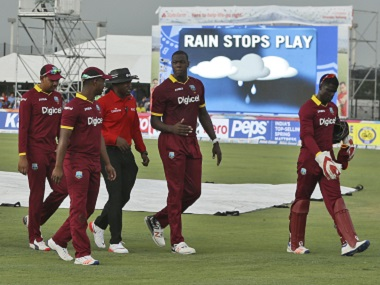 West Indies players walk off the field as rain stops play during the second Twenty20. AP