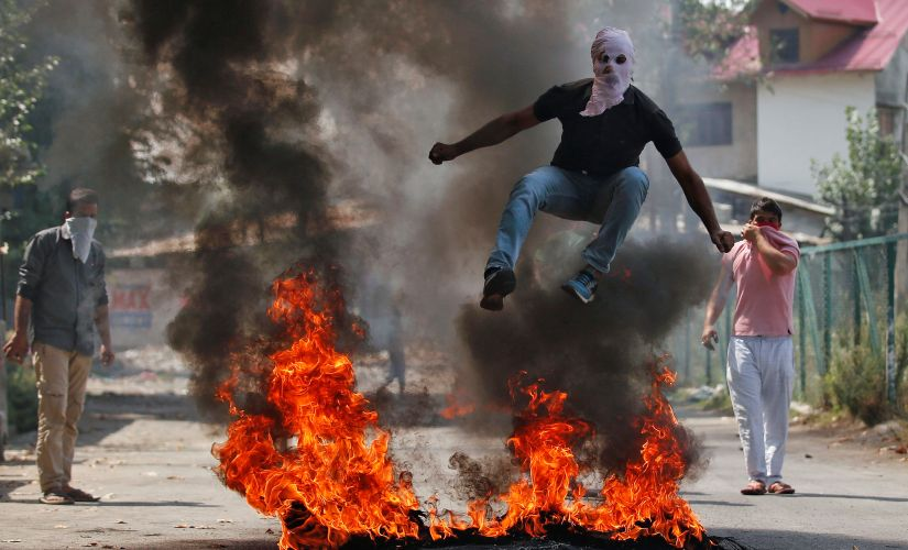 A protester during clashes with security forces in Srinagar. Reuters