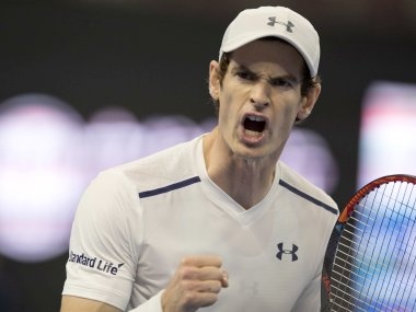 Andy Murray celebrates a point over David Ferrer at the China Open. AP
