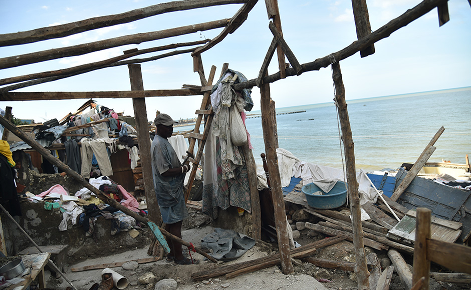A man starts repairs on his home in western Haiti. Hurricane Matthew killed at least900 people and displaced tens of thousands in Haiti before plowing northward on Saturday just off the southeast US coast and causing major flooding and widespread power outages. AFP
