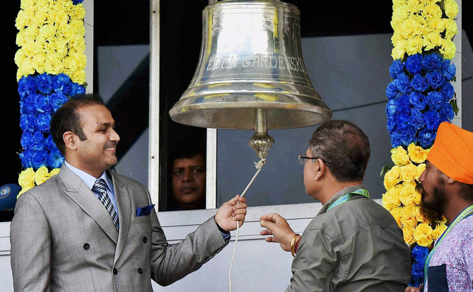 Former Indian opener Virender Sehwag rings the Eden Gardens bell to mark the start of Day three of the second Test match betwen India and New Zealand. PTI