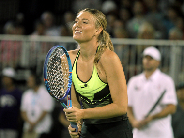 Maria Sharapova was all smiles at the charity event on Monday. AFP