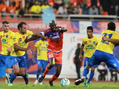 Mohamed Sissoko of FC Pune City tries to get past the defence of Kerala Blasters FC. ISL