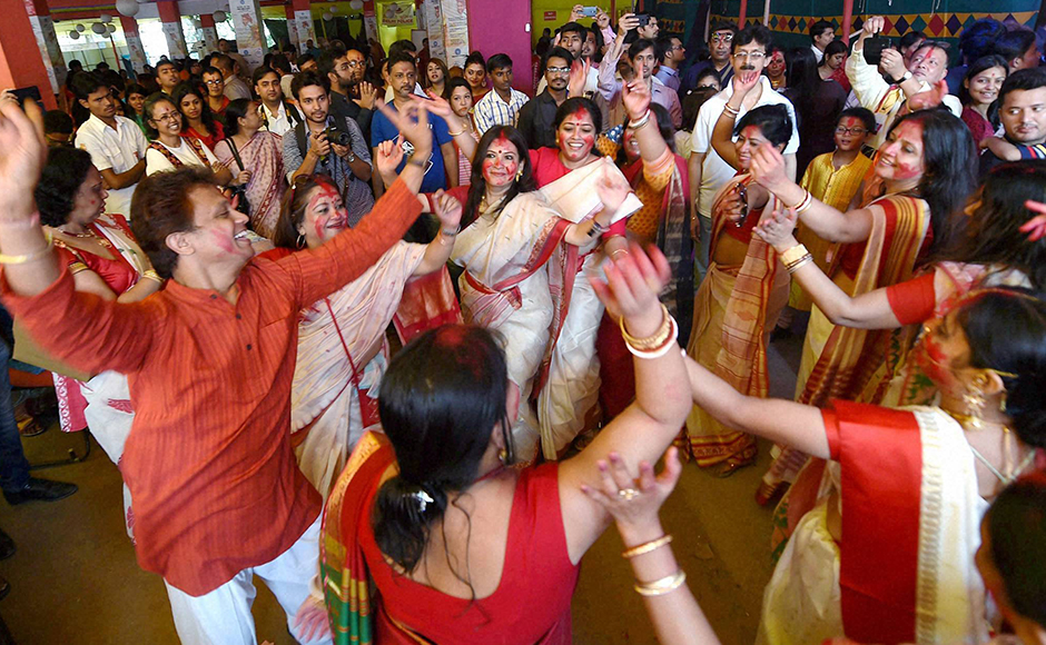 Women participate in Sindur Khela at a puja pandal on the last day of Durga puja at Chittaranjan Park in New Delhi on Tuesday. (Photo: PTI)