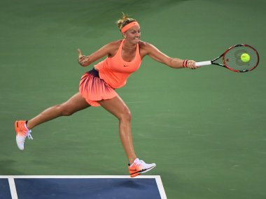 Petra Kvitova of the Czech Republic hits a return during her third round match against Angelique Kerber of Germany at the WTA Wuhan Open tennis tournament in Wuhan, in China's central Hubei province on September 28, 2016. / AFP PHOTO / GREG BAKER
