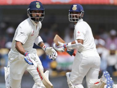 Indian cricket captain Virat Kohli runs between the wicket with Ajinkya Rahane. AP