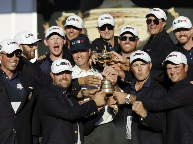 United States captain Davis Love III and players during the closing ceremony of the Ryder Cup. AP